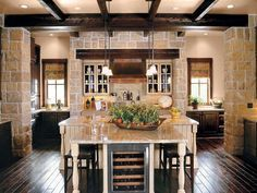 Country Kitchen with Kitchen island, Wine refrigerator, Exposed beam, Breakfast bar, Casement, T-shaped island, Raised panel