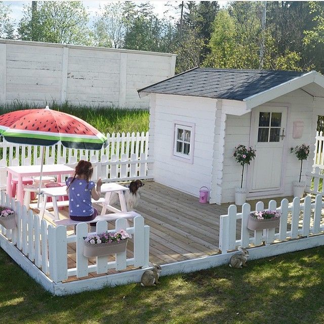 Playhouse and fenced patio