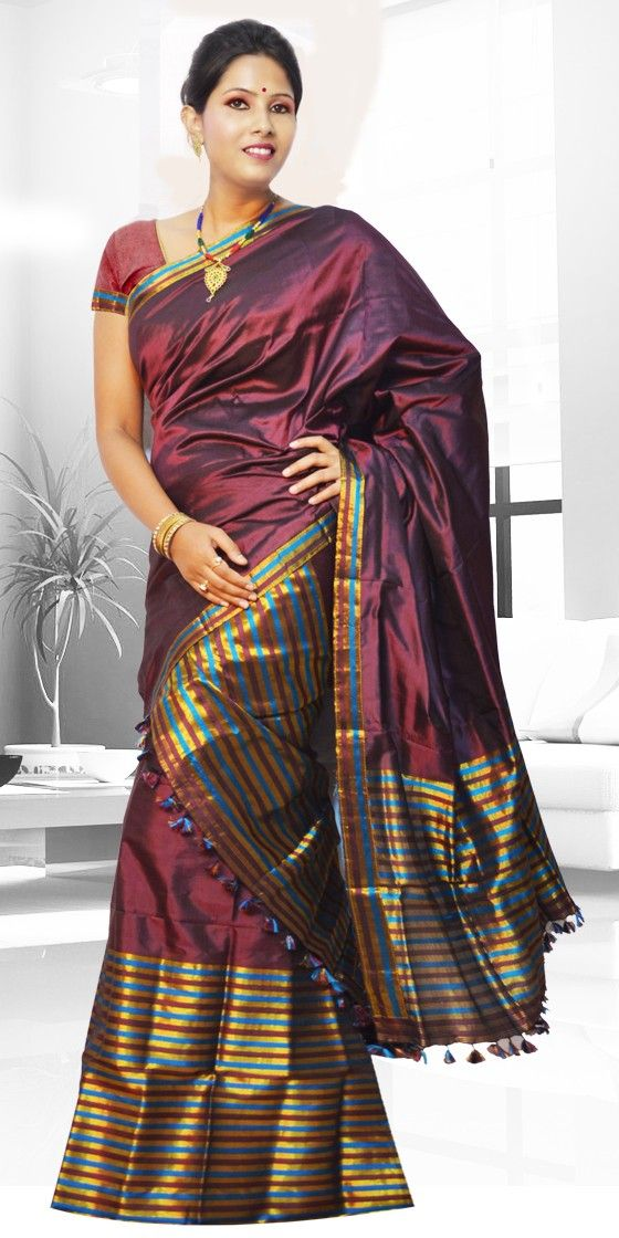 Beautiful Maroon colour Assam silk pat Mekhla Chadar with artistic Guna work giving a stylish look to the two piece. This gorgeous collection is perfect for any festive occasion.The Mekhla Chadar is a two pc. Saree which comes with matching blouse piece, the blouse shown in the image is just for display purpose.Slight colour variation may be there in display & acutal.