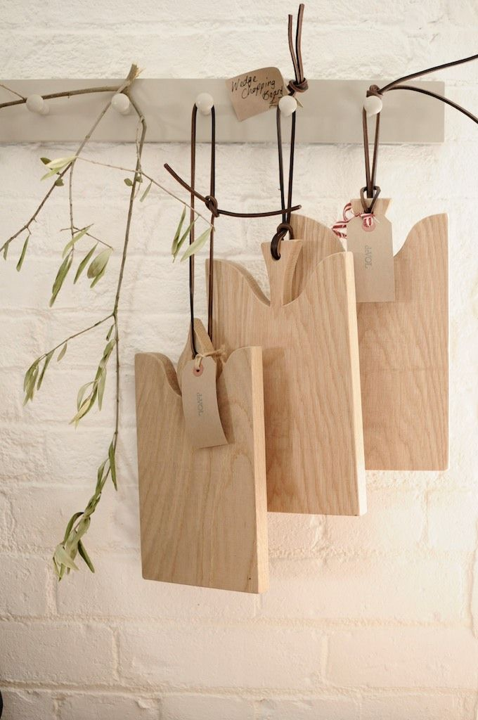 Oak chopping boards handmade by deVOL, hanging from some little pieces of leather.