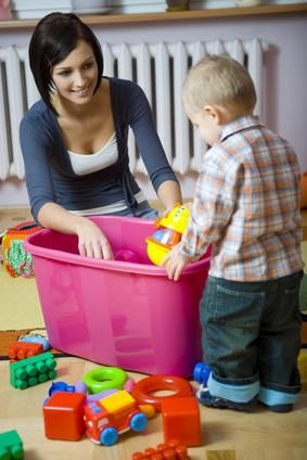 Observation Methods Educator guiding toddler through clean up routine