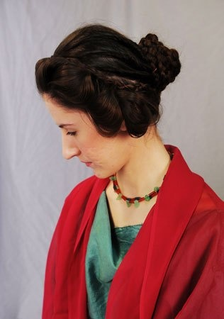 A model displays a hairstyle worn by Roman empress Faustina, by hairdresser Janet Stephens.