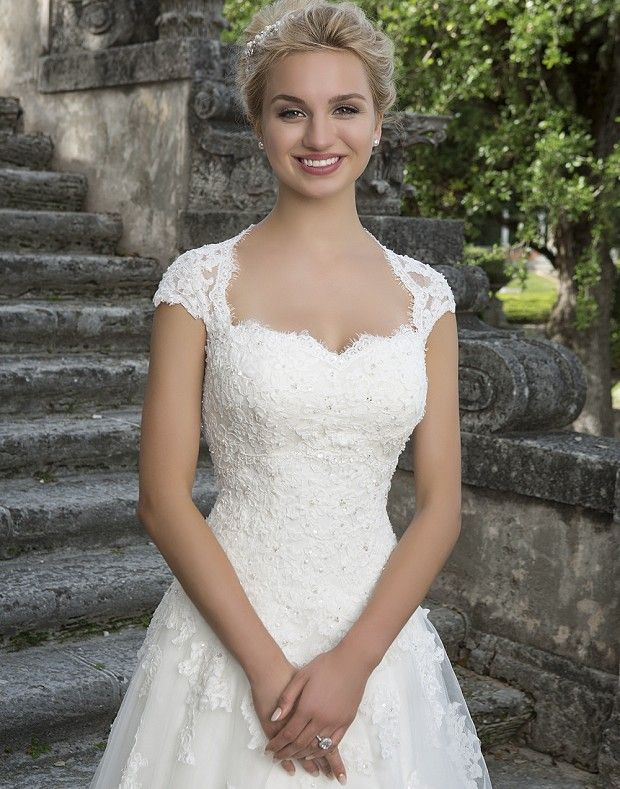 The lace Queen Anne detachable jacket, sweetheart beaded lace bodice and full tulle skirt of this ball gown create a classic, princess look.