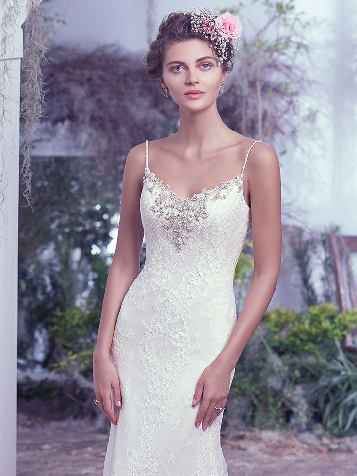 Shop The Maggie Sottero Kaari Wedding Dress Swarovski Crystal Accents Beads And Pearls Embellish This Soft Lace Sheath Gown With A Low Scooped Illusion