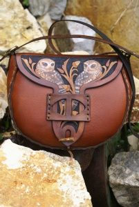 warm tan tab fronted bag with antler toggle and carving of little owls
