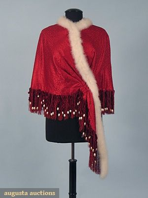 """RED SILK DAMASK EVENING CAPE, 1880s  Trimmed w/ white swan's down, red chenille, & silk fringe, inside lining quilted cream silk, L 19"""", Fringe 5"""""""