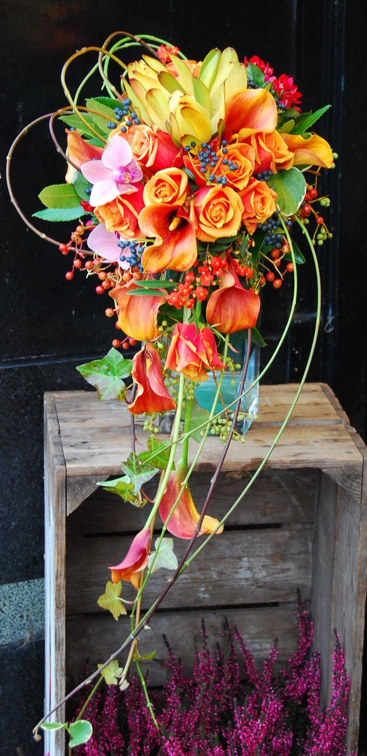 Agata Gryszak. Gorgeous flow created in this cascade bouquet using ivy and calla lilies.