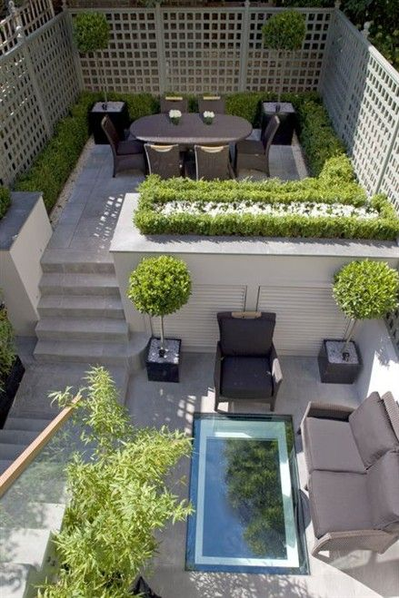 Clever design for a contemporary courtyard garden set out on different levels, the hard & soft landscaping giving a really modern feel to the design