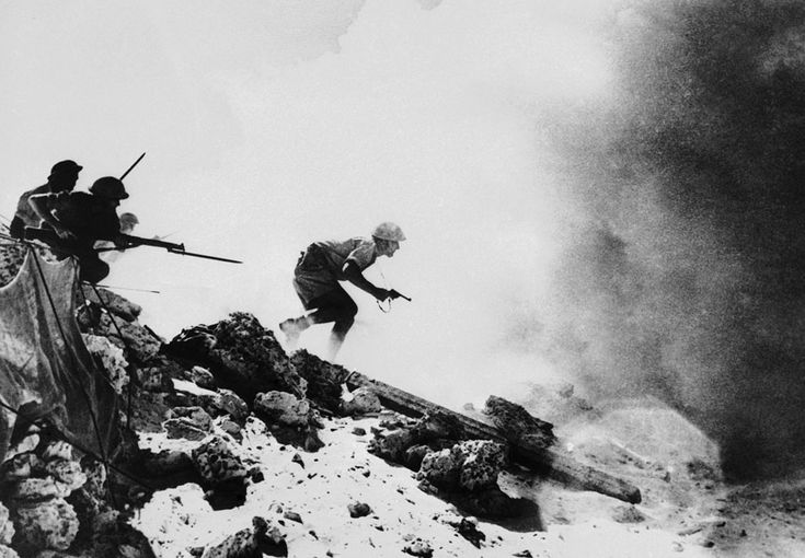 Australian troops approach a German-held strong point under the protection of a heavy smoke screen somewhere in the Western Desert, in Northern Africa on November 27, 1942. (AP Photo)