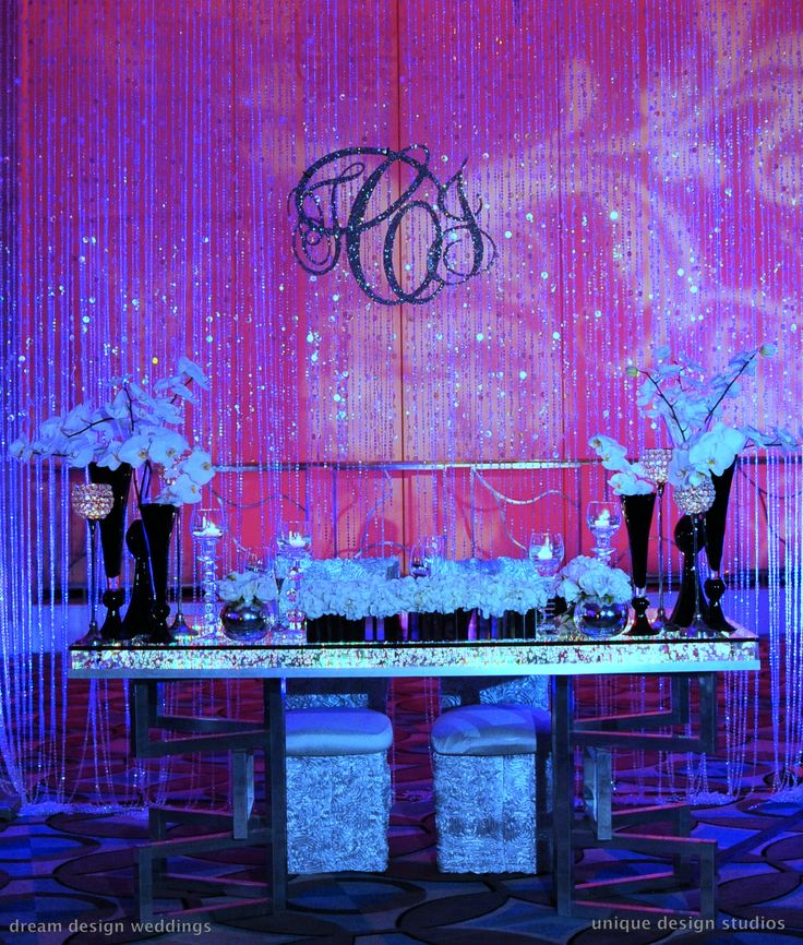 Bling sweetheart table with crystal curtain backdrop and bling monogram. Wedding planning and design by Tiffany Cook Events