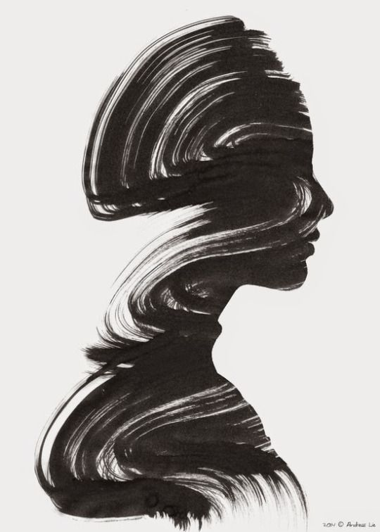 Positive and negative space shown in a painting of a woman (in black paint) where only her face and front part of her torso is recognizable. Pretty cool.