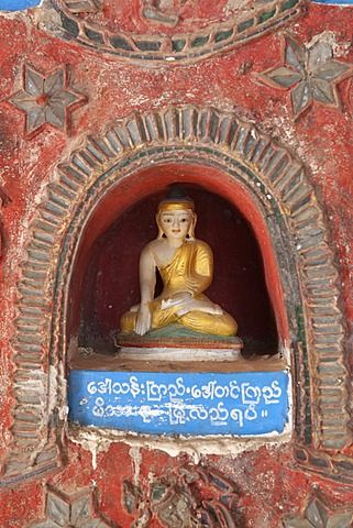 Buddha offerings in wall niche, Shwe Yan Pyay monastery, Nyaungshwe, Inle Lake…