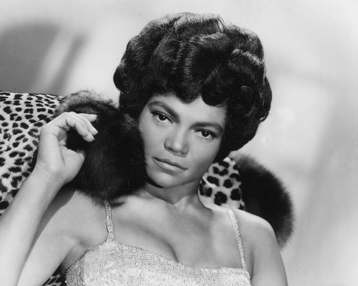 """Eartha Kitt in 1960: Orson Welles once called her the """"most exciting woman in the world"""" and that may just be true. The original carefree black girl was known to speak her mind and wore many hats as an actress, singer, cabaret star, dancer, stand-up comedian, activist and voice artist. In 1953 two of her songs, """"Santa Baby"""" and """"C'est Si Bon"""" made the US Top Hits list."""