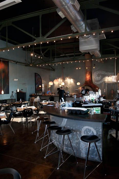 Open warehouse-style beams and ceiling at West First Pizza
