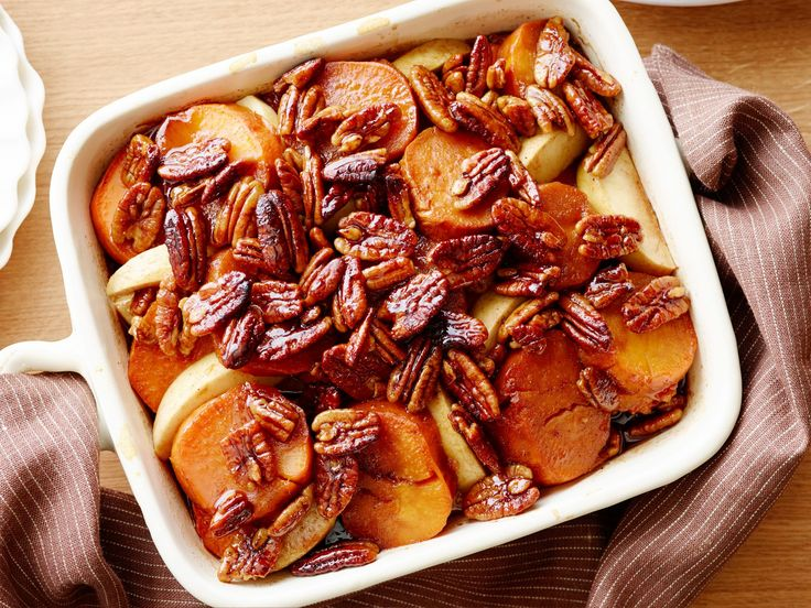 Whiskey-Glazed Sweet Potatoes : Guy adds a bit of whiskey to his mixture of sweet potatoes and apples and sweetens the dish with agave nectar.