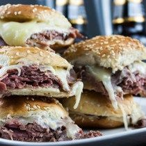 Roast Beef Sliders with Horseradish Sauce - A creamy, spicy, horseradish sauce, layered with thinly sliced roast beef covered with gooey, melty cheese in a hand size toasty bun. #gameday