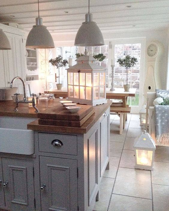The kitchen. White and wood again, but I just love be it! Bit shabby chic bit country but modern lots of warmth