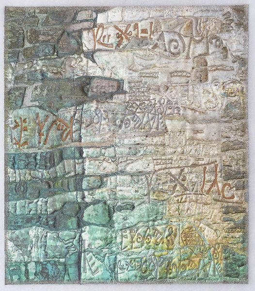 Messages in the Stones quilt by Charlotte Ziebarth.. A combination of photography, digital art alterations, and layering and stitching on cloth, allows the artist to tell a multi-layered story