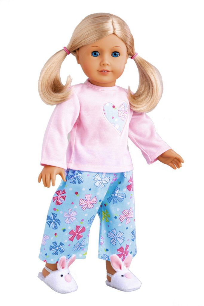 Pink cotton pajama top with decorative heart, blue caprice and white bunny slippers.    Doll Pajama contains a wide back closure for easy dressing and clothing removal. Our doll clothes fits 18 inch American Girl dolls. Designed in the USA and sold Exclusively by DreamWorld Collections. DOLL(S) NOT INCLUDED U.S. CPSIA CHILDREN'S PRODUCTS SAFETY CERTIFIED