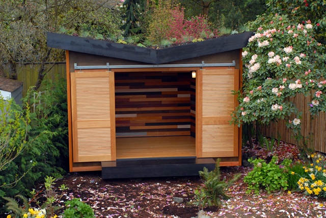 Small tool shed sized zen tea house created by sutton for Japanese garden shed