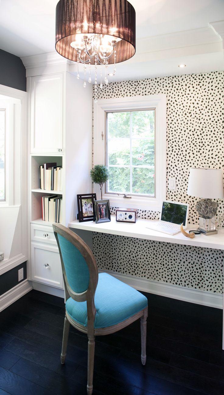dalmation walls & blue chair with fun chandelier & dark floors!