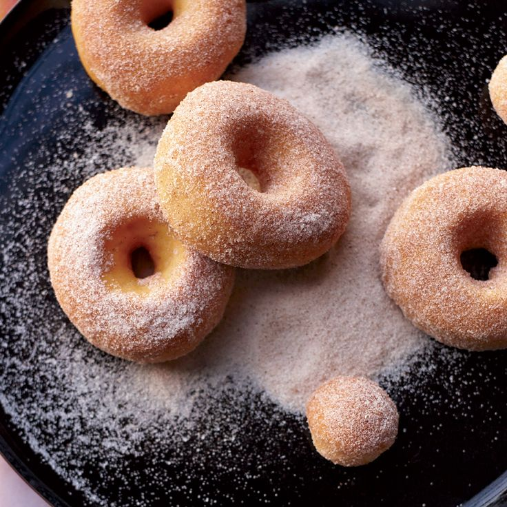 Baking the doughnuts and tossing them with a little butter, cinnamon and sugar makes them healthier than fried doughnuts.