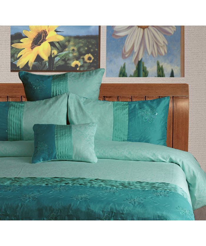 """Contempory bedlinen for your home. The """"Bella - Aqua"""" Jacquard quilt cover set, is made from high quality jacquard, polyester and cotton fabric and has a knife edge finish. This design combines pintucKing on the quilt cover and accessories with a touch sequins in a floral design. This design is sure to smarten up your bedroom."""