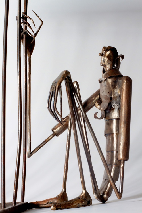 Metal and wood fabrication artist Colby Murray does some amazing work. Drawing on the apparent influence of Tim Burton, Giger, and classic fantasy, he manages to breathe life into what could be a very cold medium and create the tin man with a heart.