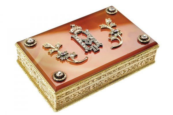 """Faberge, A snuff box of the property of tsar Nicolaus II -Having a rectangular shape, red gold lateral sides, finely engraved with yellow gold floral motifs. On the cover the crowned monogram """"N II"""" with branches of flowers and leaves decorated with diamonds and rubies, diamonds on crowns of leaves at the four corners. The stamp """"FABERGE"""", """"72"""", head on the right and """"MP"""" (in Cyrillic for Michael Perkhin).Michael Evlampievic Perkhin (1860-1903)."""
