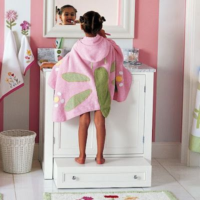 pull-out step stool for sink. Good design to keep in mind especially for a Jack n Jill bathroom. If the counters are higher then build this into the design for kids