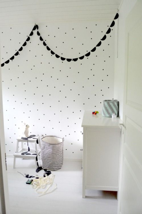 Ooooh I love this! The bunting and dots are unisex, and I like how the other decor continues with the colour combination