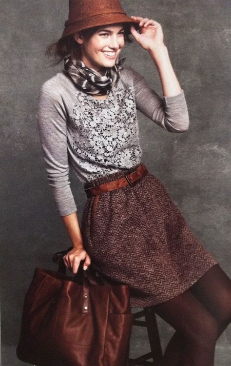 Black lace top + tweed skirt + fossil belt + brown tights