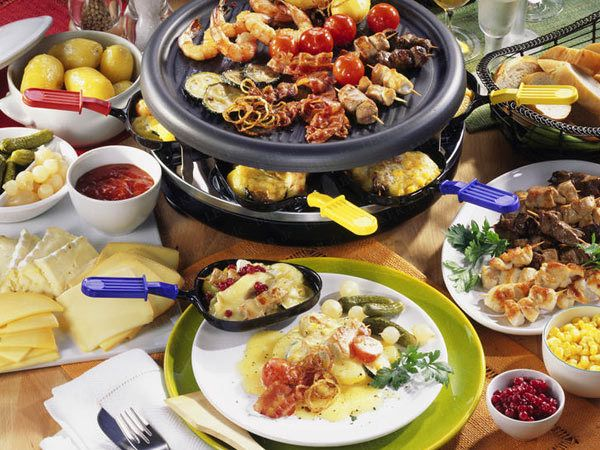 Raclette, a Swiss/French dish (named after the raclette cheese) dates back to the medieval times in Europe. Today, it involves a modern electric table-top grill with small pans and the hot top of the grill. Vegetables and meat are then prepared on the grill and topped with melted raclette cheese. Watch out for this delicious dish as it will soon be served by one of Cozymeal's (www.cozymeal.com) hosts in San Francisco!