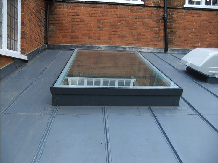 Single ply membrane roof, (sarnafil or similar) with applied decor strips to mimic a standing seam metal roof.