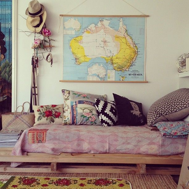 this Aussie bedroom/lounge has such a casual, feminine and yet grounded feel to it.  fantastic colors and layers, fun hats hung on branches, and that vintage yellow and aqua map is fabulous