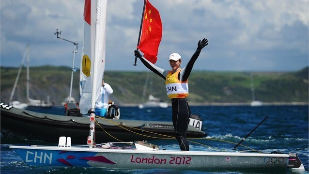 Xu Lijia of China celebrates winning gold in the Laser Radial Women's Sailing on Day 10 of the London 2012 Olympic Games at Weymouth & Portland.