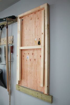 Fold-up Garage Work Table. Describes the kinds of hinges used for the legs. Use X-shaped cross-bracing instead of H-shaped, beadboard (wallpaper) the underside, paint white, and add crown moulding to the support timber.
