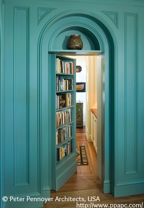Turquoise Secret Library Door in a traditional mansion library in Maine.   ©  PETER PENNOYER Architects. See 'Gallery' - 'House in Maine' - page 15. Decorator: Thomas Jayne Studio. Photographer: Jonathan Waller ...