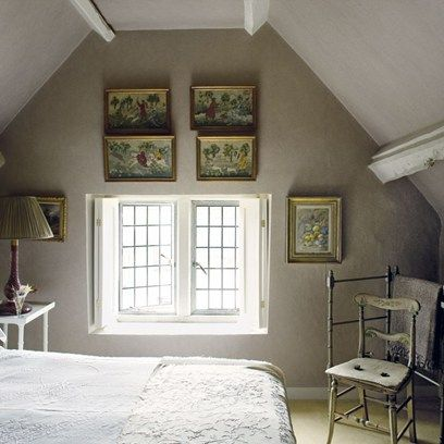 attic country bedroom with a gallery wall.