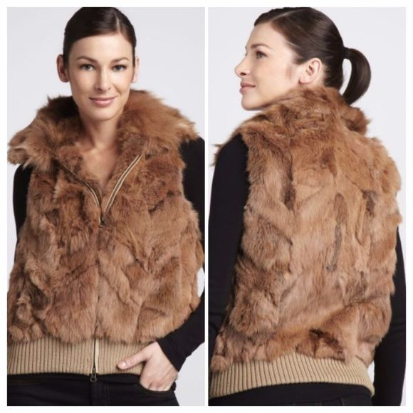 Jocelyn Fox-Collared Rabbit Fur Vest Jocelyn like NEW bought from Neiman Marcus Fox-Collared Rabbit Fur Vest Easily one of the most versatile pieces you can acquire, this Jocelyn vest features two types of fur for a lush, textural presentation. •Dyed rabbit with dyed fox collar. •Spread collar; zip front. •Sleeveless. •Ribbed wool/acrylic knit hem. •Polyester lining. •Imported. Jocelyn Jackets & Coats Vests