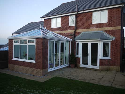Nowadays, Orangeries provide a beautiful alternative to the traditional conservatory or extension. Designed with solid built columns, a partial solid ceiling and inclusion of a roof light or otherwise known as an atrium, they are a well balanced mix of traditional extensions, garden rooms and summerhouses.