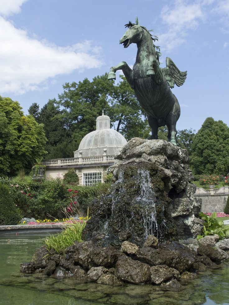 Schloss_Mirabell_Salzburg_Pegasus fountain (1913) and Vogelhaus aviary, ca. 1687 The famous gardens of Schloss Mirabell were begun in 1606, but their present form is closer to the 1690 layout by Johann Bernhard Fischer von Erlach and especially the later 1730 changes by Franz Anton Danreiter. The originally strict baroque design already featured notable preserved elements such as the orangery and the aviary (Vogelhaus), and was later complemented by more pl...