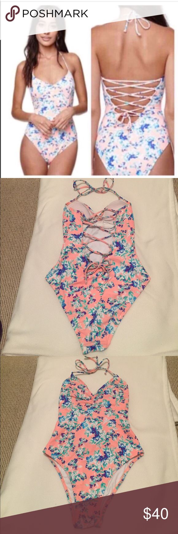 La Hearts Lace Up One Piece Light peach color with flowers. Lace up back. V neck and gathering at the bust. Very cute! Selling because too small for me. Light padding in the top. Willing to negotiate LA Hearts Swim One Pieces