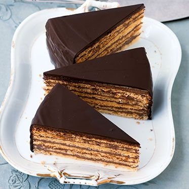 Prinzregententorte: a cake that consists of at least six thin layers of sponge cake interlaid with chocolate buttercream, the exterior is covered in a dark chocolate glaze. Brought to Uruguay by the German immigrants from Bavaria.