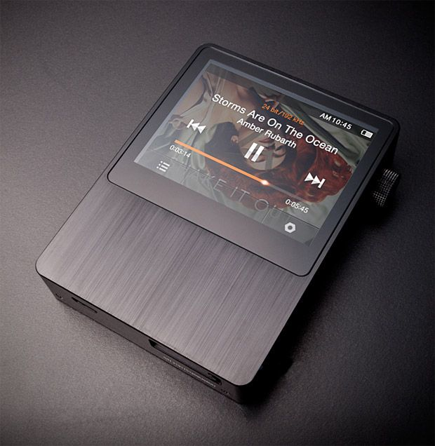 Astell AK100 Portable Audio System.    Comparing this high-end portable audio system to an iPod is like comparing a Ferrari to a Ford Fiesta. The AK 100 features 32GB of storage, 16-hour battery life, a 2.4-inch touchscreen, & a super-sharp Wolfson DAC. It's capable of playing MQS, Ogg, FLAC, WAV, WMA, APE, and even MP3 files. And if these file types don't compute, stick with your Fiesta.
