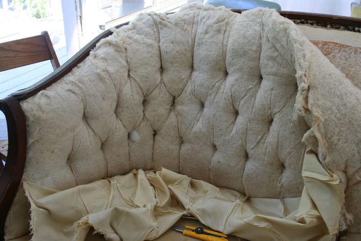 This woman takes a vintage couch down to its bones and redoes the whole thing step by step with products, prices and comments. AWESOME!