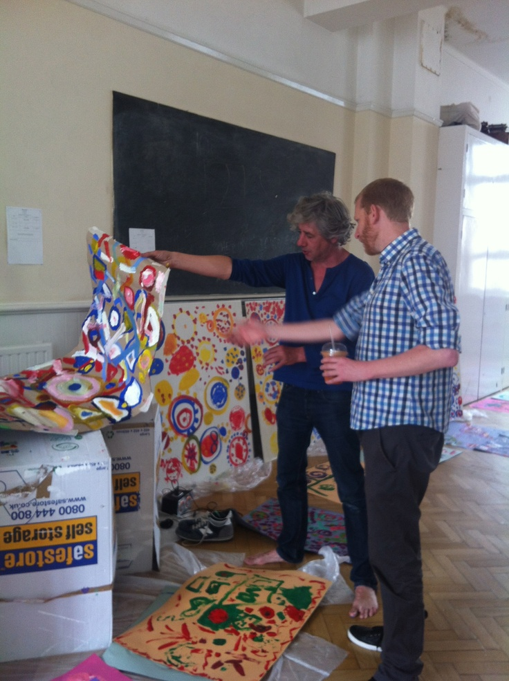 Hervé Tullet shows Pop Up Festival Director Dylan Calder the results of the work with schoolchildren that afternoon