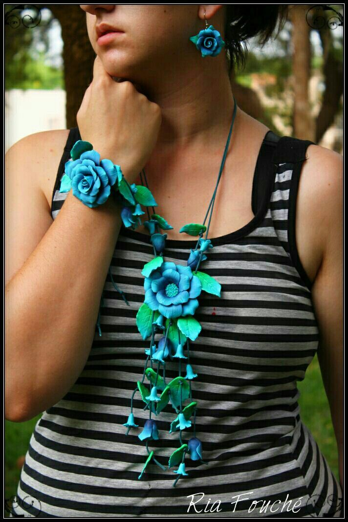 Open rose set in turquoise  and green