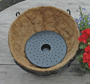 Flower Well is a sturdy plastic reservoir for hanging baskets and planters that captures water and food that would otherwise drain away. So your hanging baskets can go longer before watering and dripping is much reduced