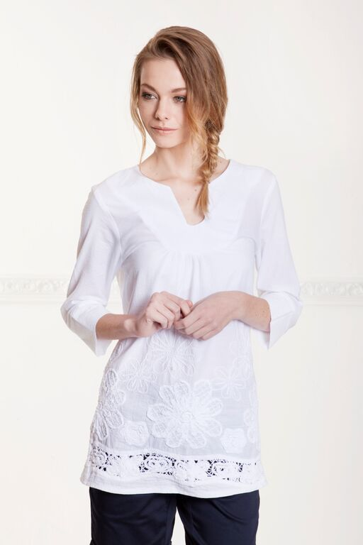 White Majorelle embroidered cotton tunic. Perfect for the coast holidays. 30-40 available. To order email: melissa@hermannarush.com